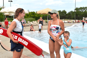 Lifeguard with mom and kid