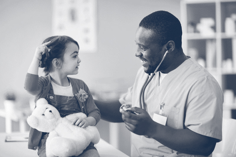 doctor with young girl