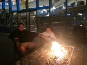 Child with autism relaxing around the fire at Sawgrass Marriott after a long day