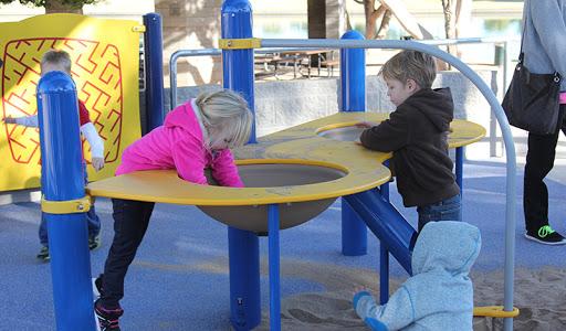 8 kids playing on playground in park in mesa arizona