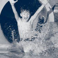 boy on water slide