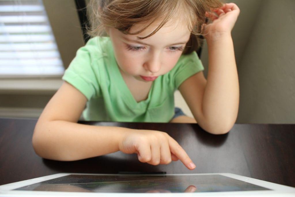 little girl on ipad