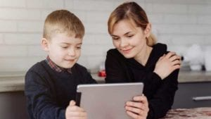 Mother-helping-son-with-teletherapy-as-facilitator