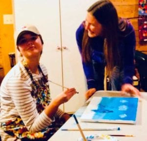 teen girl painting with instructor at HEARTism