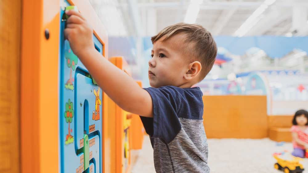 Boy-playing-at-therapy-center-for-speech-language-pathology-and-occupational-therapy