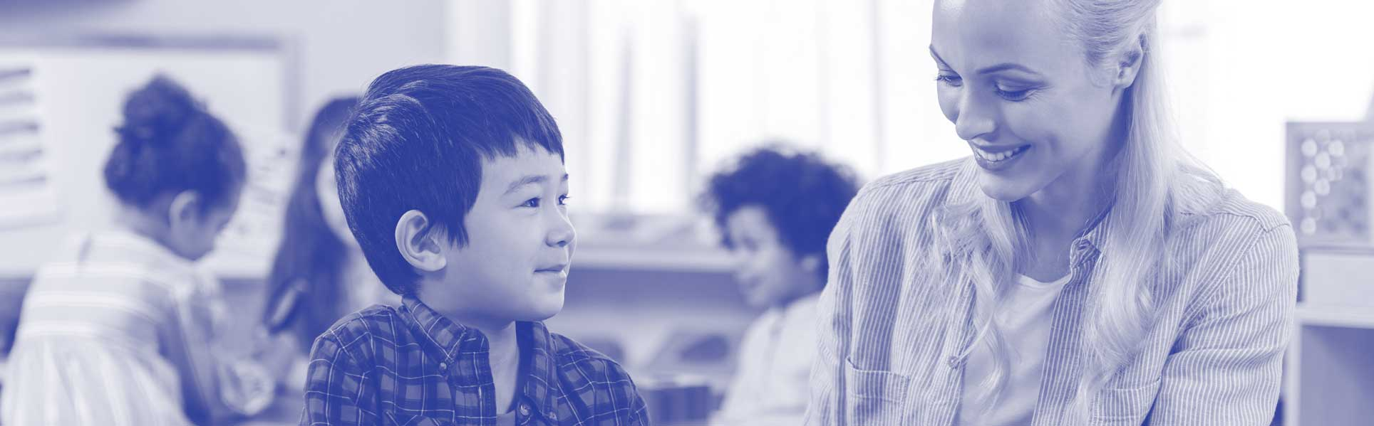 Teacher smiling and young asian student