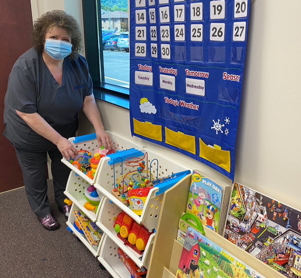 Staff Member setting up room with games and toys