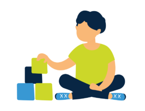 young autistic boy playing with blocks