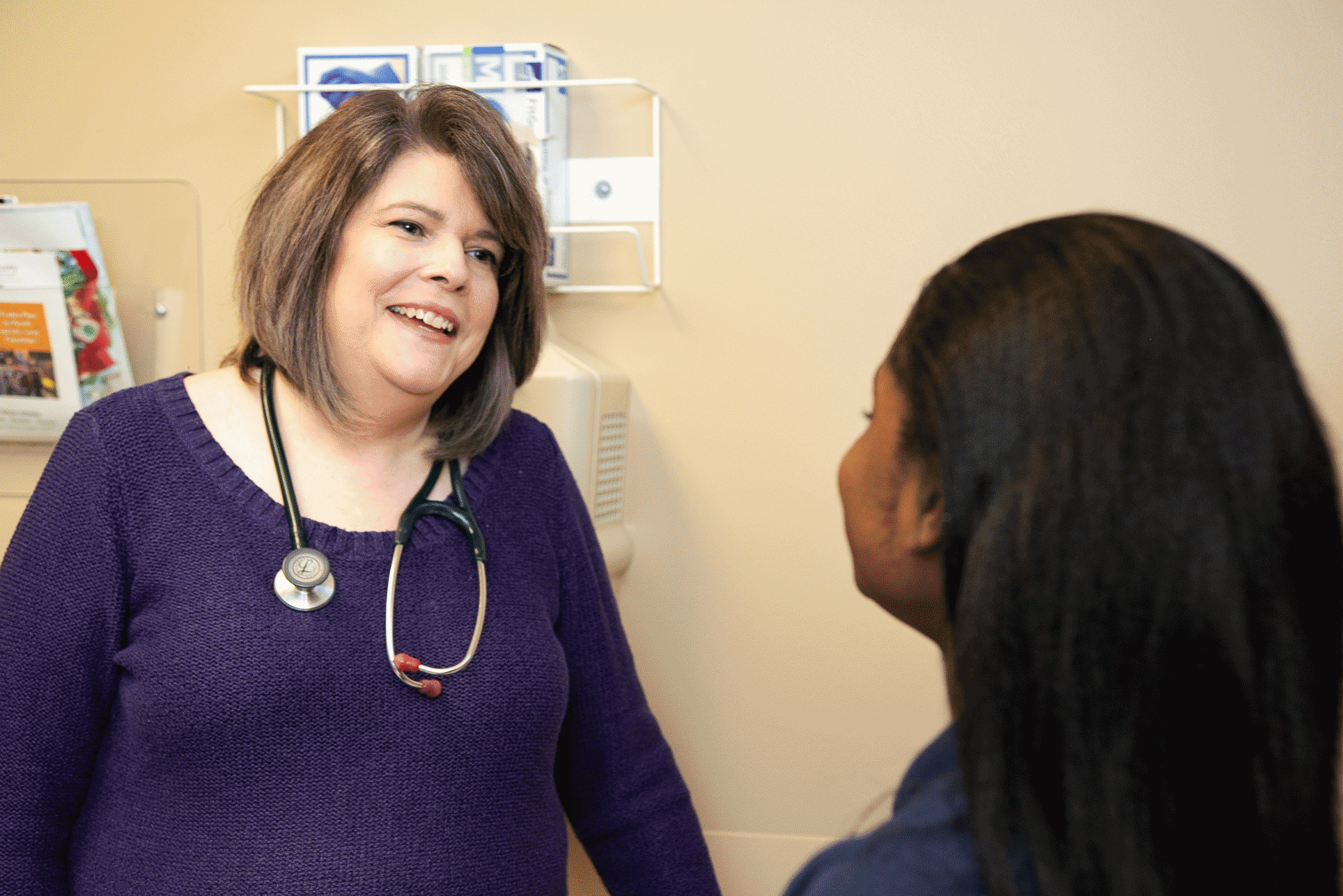 doctor talking with patient at St. Tammany Pediatrics Clinic