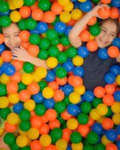 Kids playing in sensory ball pit at First Step