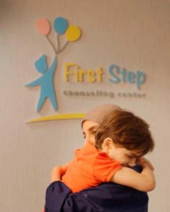young patient hugging First Step staff