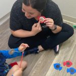 Staff working with child at Cutting Edge Therapy
