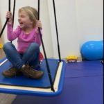 Girl on swing at Cutting Edge Therapy