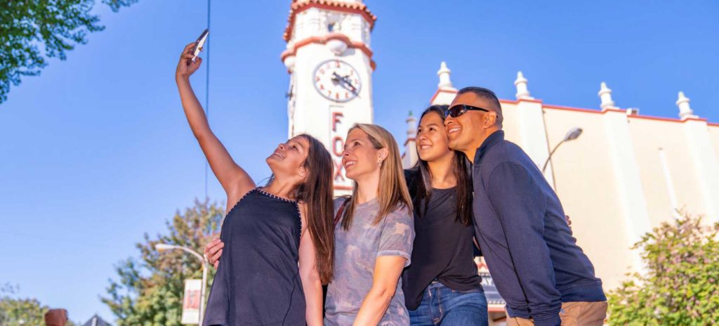 Visit Visalia family of four taking selfie in front of Fox Theatre